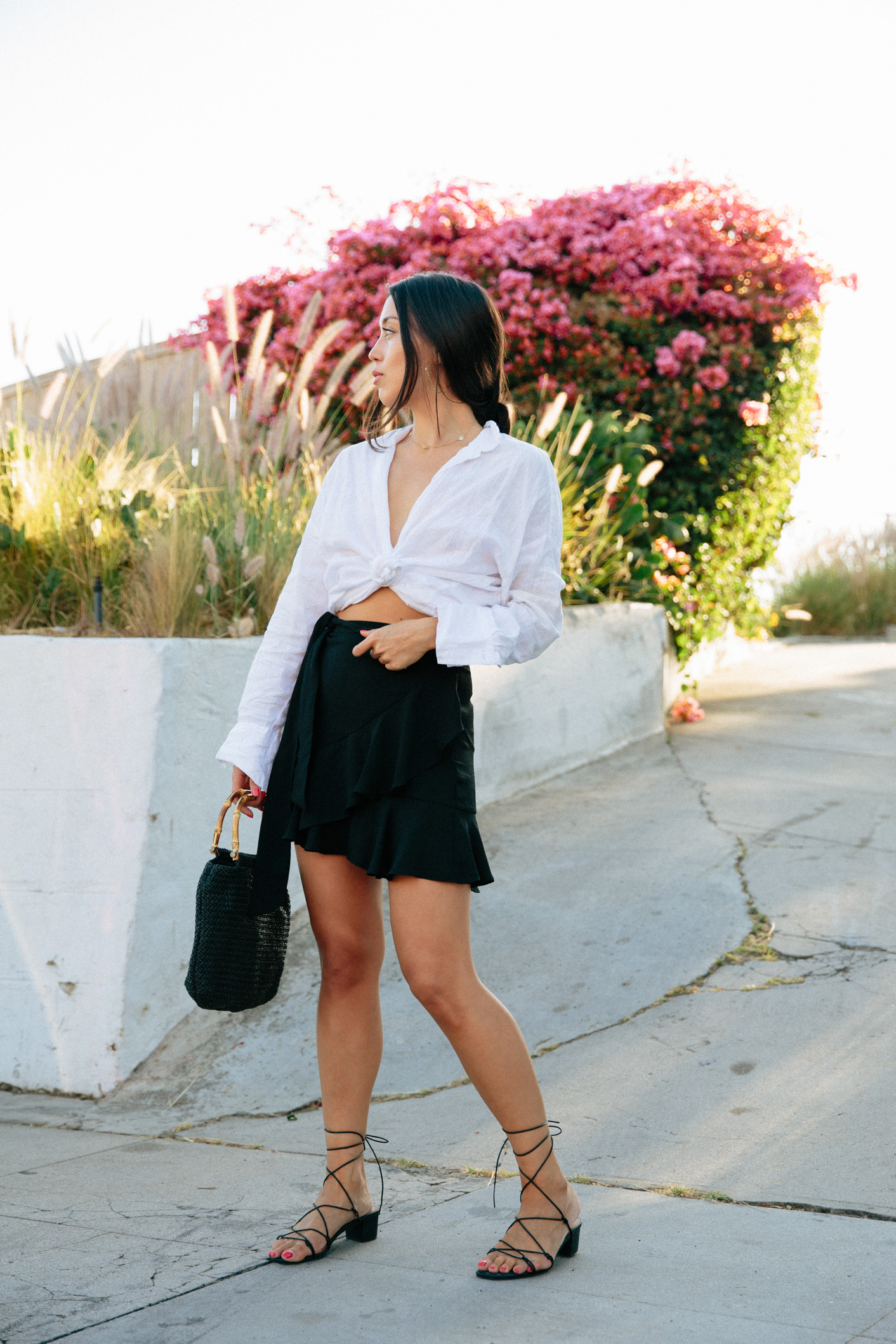 Emily Tong of Love Or Money Blog wearing linen shirt and flounce skirt