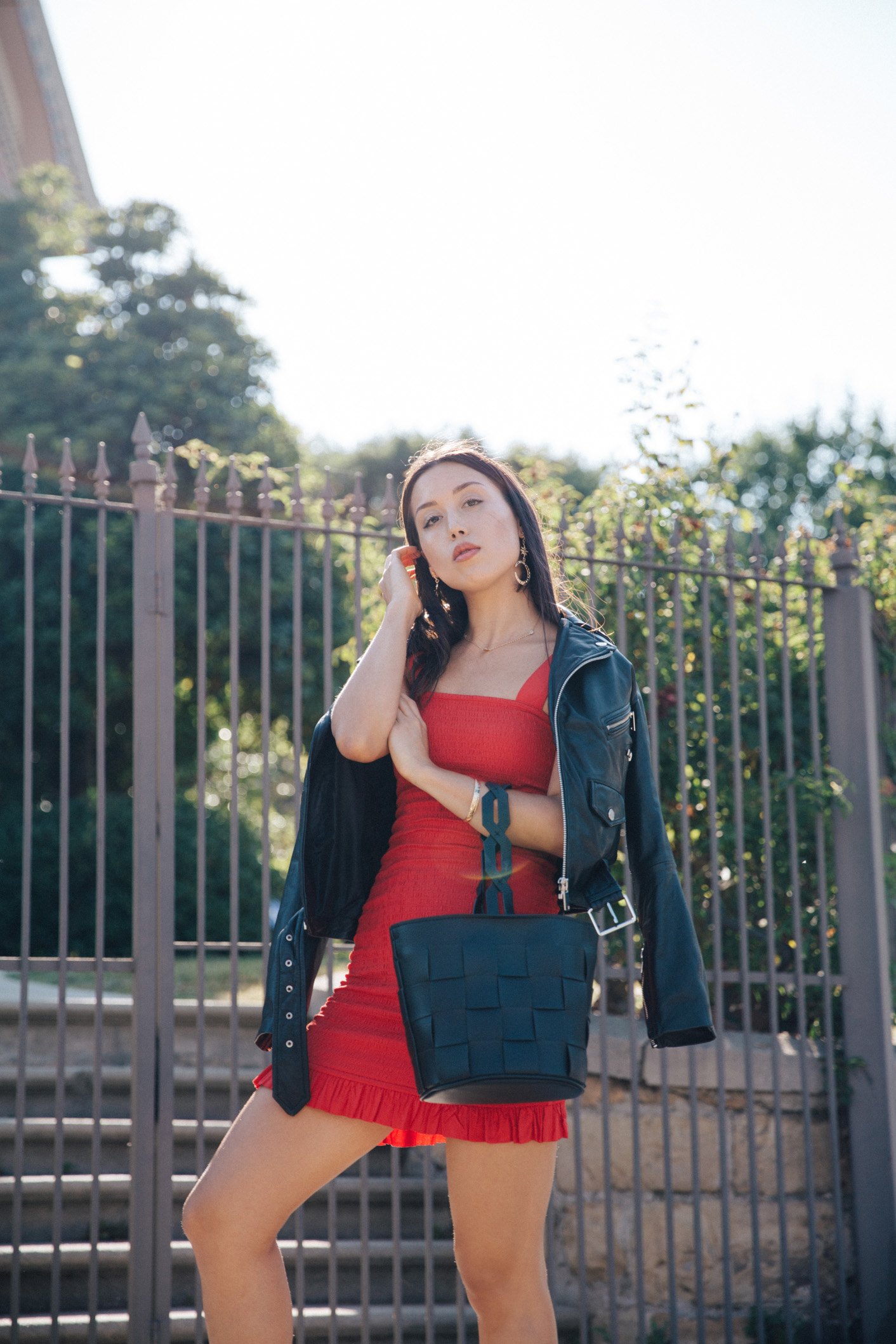 LOVE OR MONEY by Emily Tong wearing red smocked mini dress and espadrilles in LA