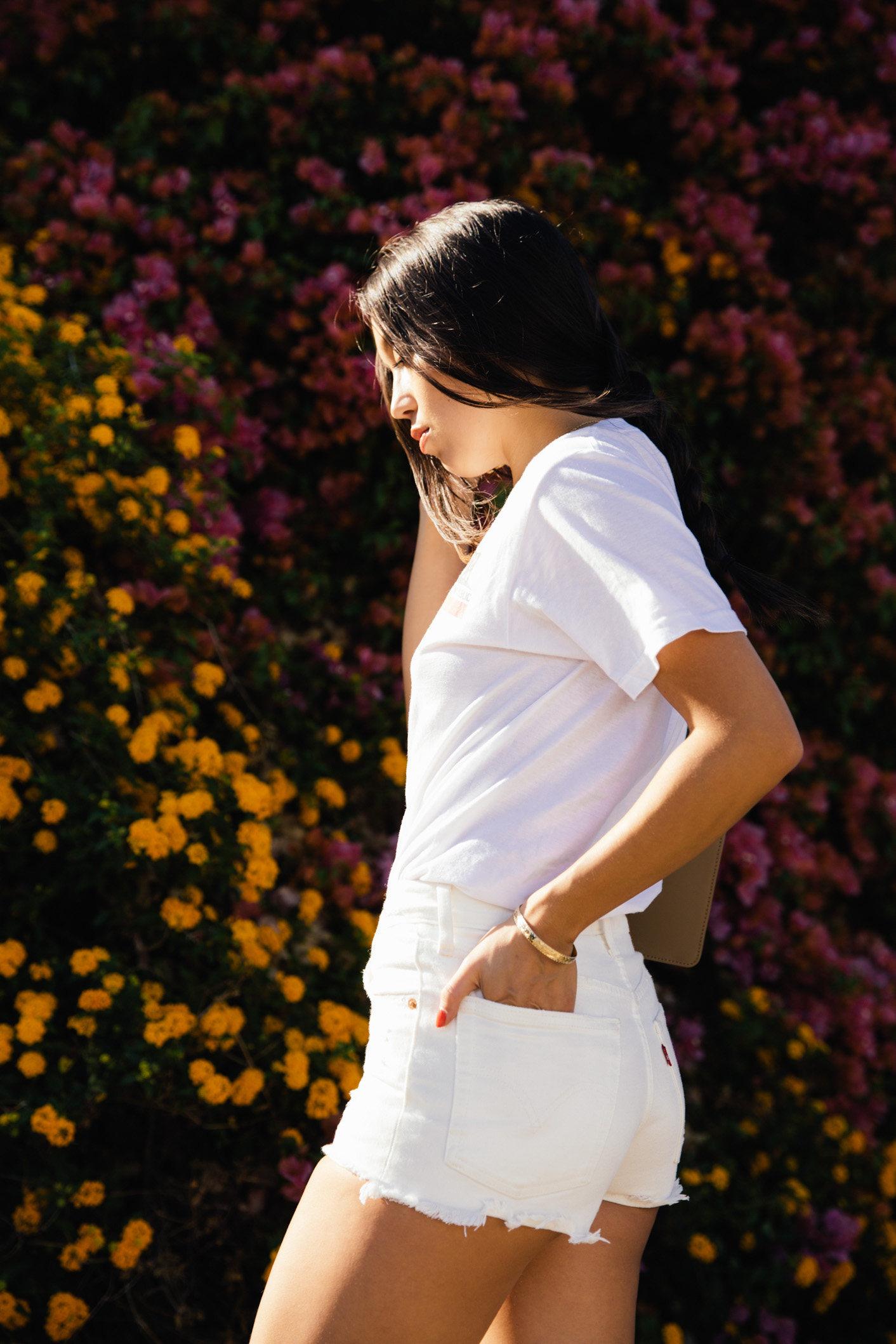 LOVE OR MONEY by Emily Tong wearing all white outfit and California bear tee