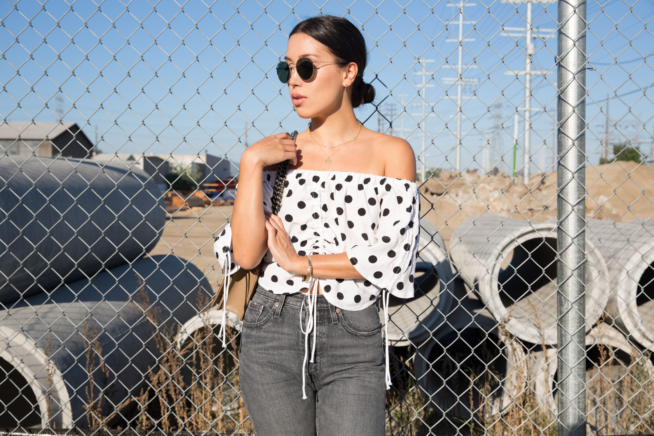 LOVE OR MONEY by Emily Tong wearing polka dot crop top and jeans