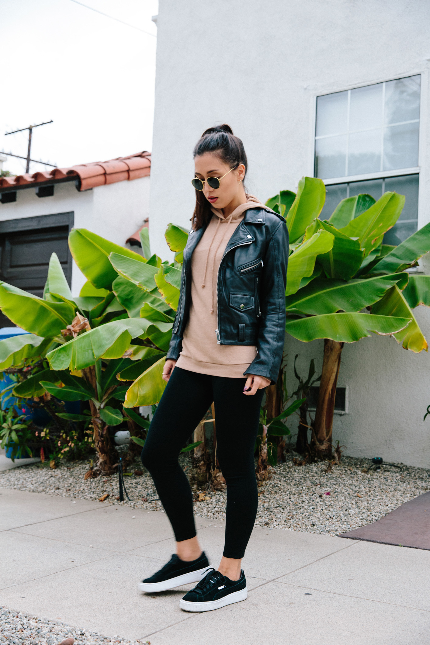 LOVE OR MONEY by Emily Tong wearing casual athletic outfit with leather jacket
