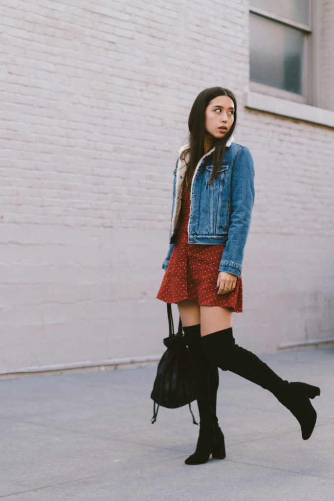 LOVE OR MONEY by Emily Tong wearing Reformation dress Levi's jacket and over the knee boots
