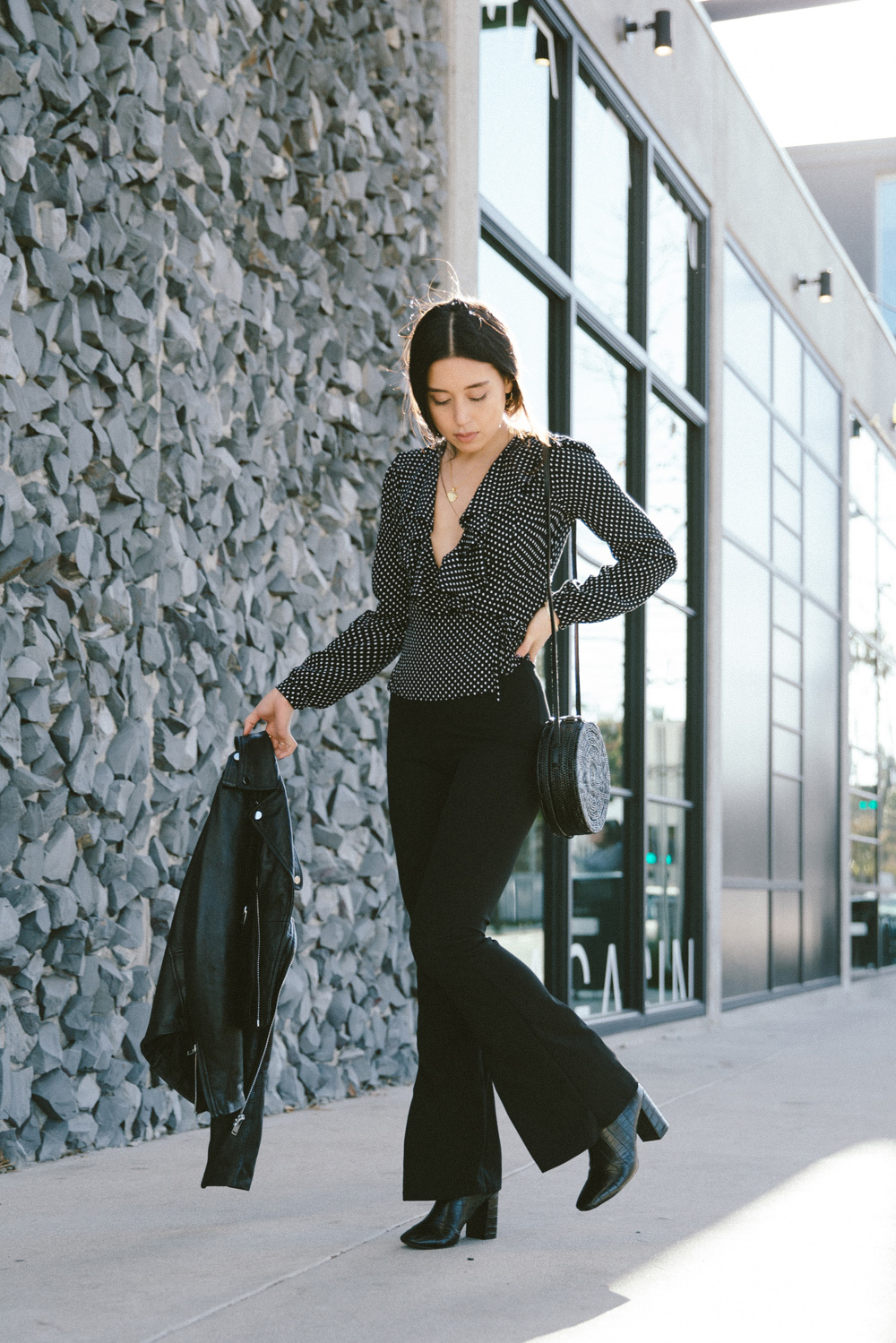LOVE OR MONEY by Emily Tong wearing polka dot top and flare pants