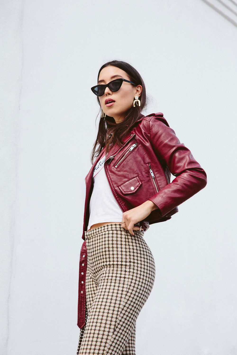 LOVE OR MONEY by Emily Tong wearing Mango checker pants graphic tee red leather jacket and satin heels