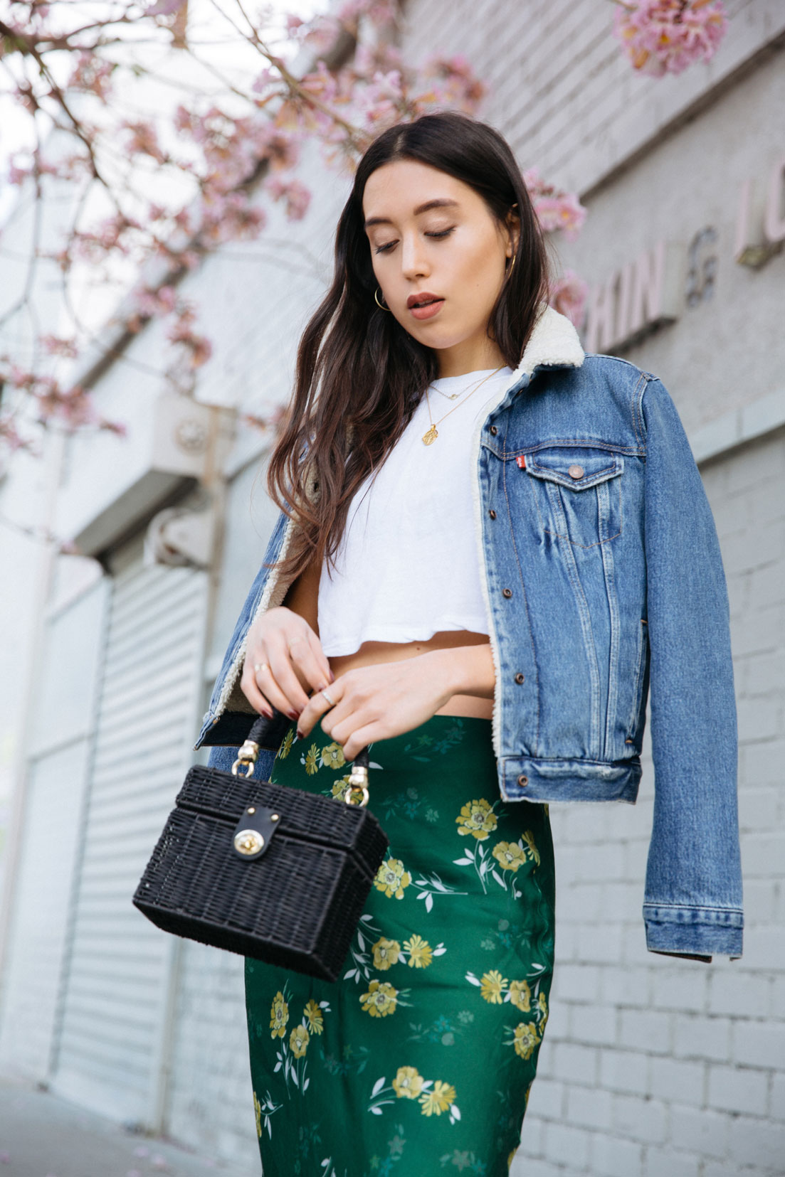 LOVE OR MONEY by Emily Tong wearing urban outfitters floral midi skirt brandy melville top levi's sherpa jacket topshop sandals and zara bag