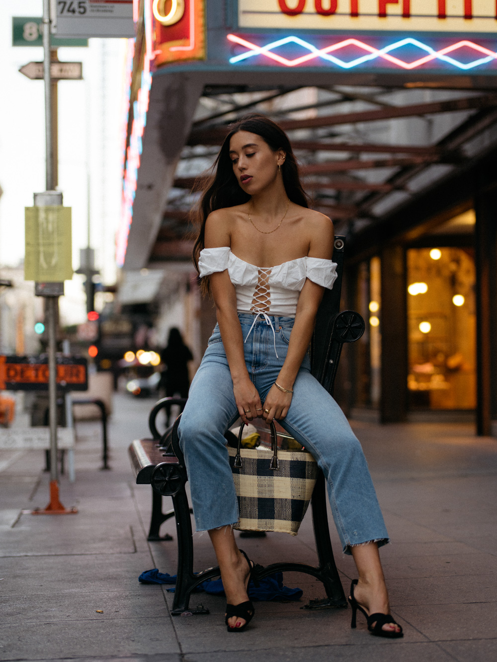 LOVE OR MONEY by Emily Tong wearing white corset crop jeans and gingham purse in LA