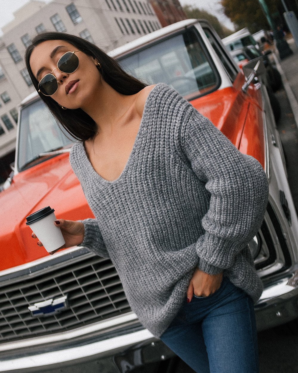 LOVE OR MONEY by Emily Tong wearing Closed Knit Sweater