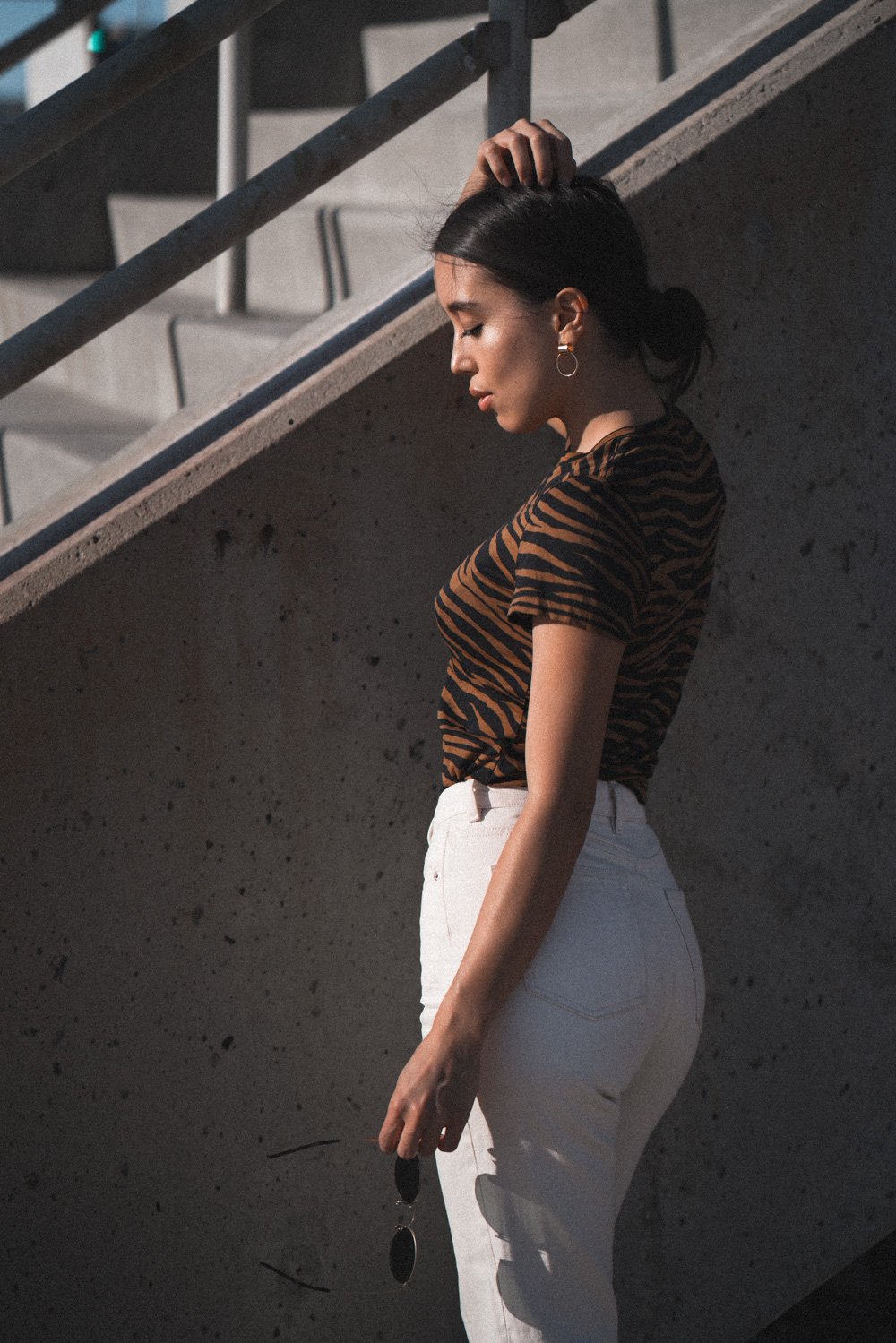 LOVE OR MONEY by Emily Tong wearing And Other Stories Zebra Top and White Jeans