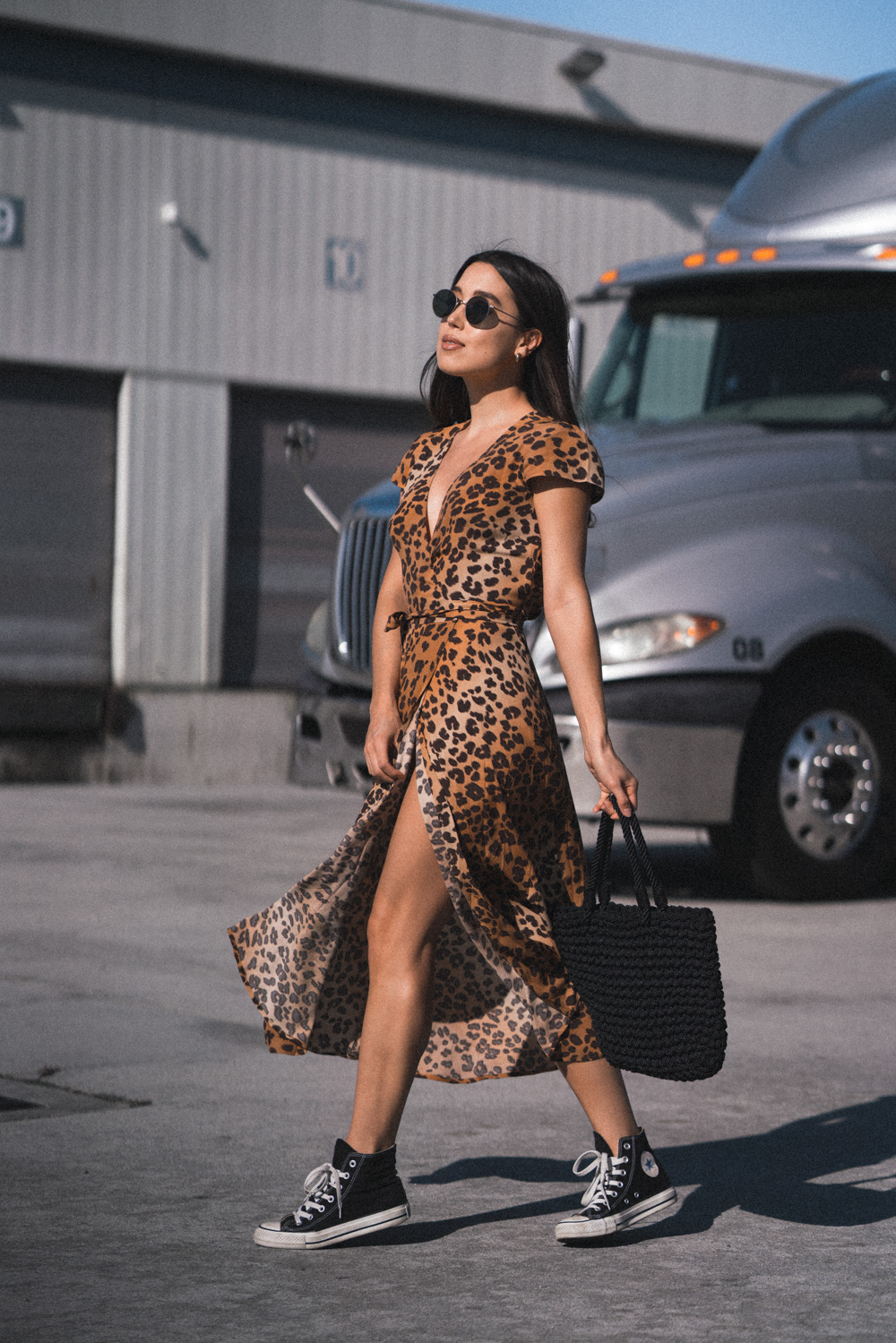 LOVE OR MONEY by Emily Tong wearing Other Stories wrap dress in leopard print and sneakers