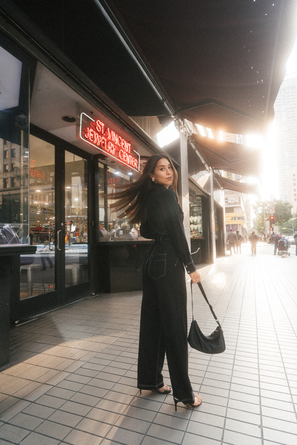 Fashion blogger Emily Tong wearing Stories jumpsuit and thong heels in Los Angeles