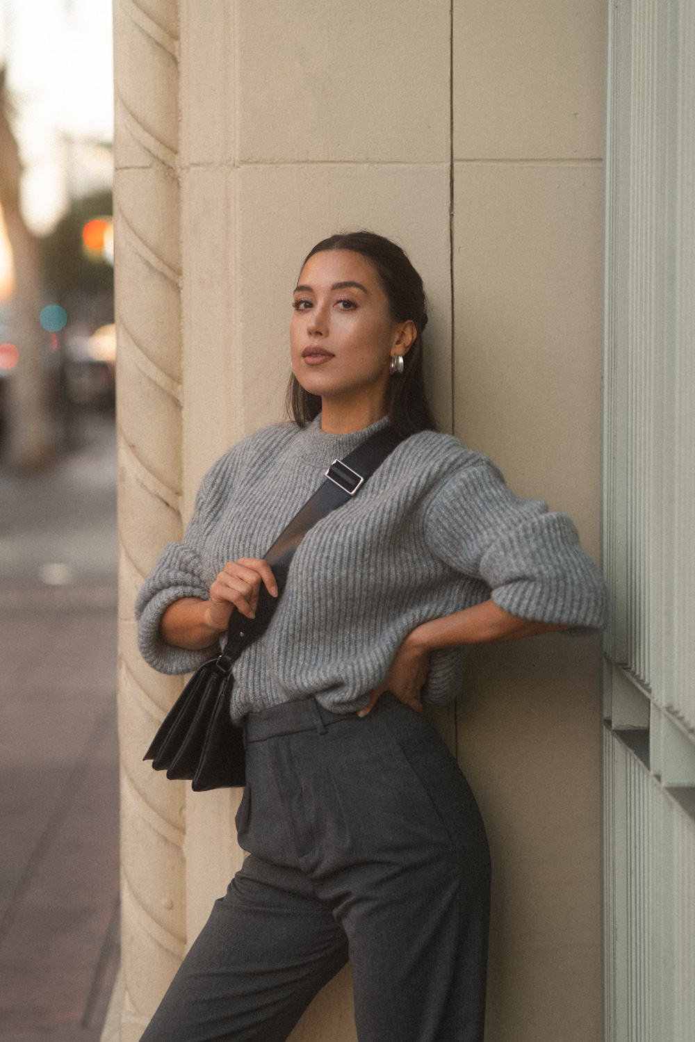 LOVE OR MONEY by Emily Tong wearing Closed wool sweater and Zara trousers