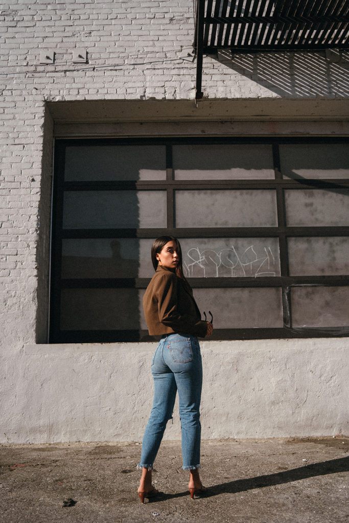 LOVE OR MONEY by Emily Tong wearing crop blazer and Levi's wedgie jeans
